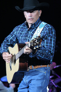George Strait, playing guitar and crooning (2008).